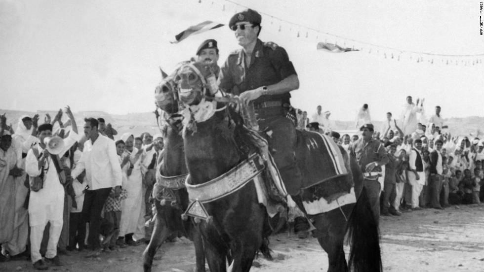 Gadhafi rides a horse through Tripoli in November 1975.