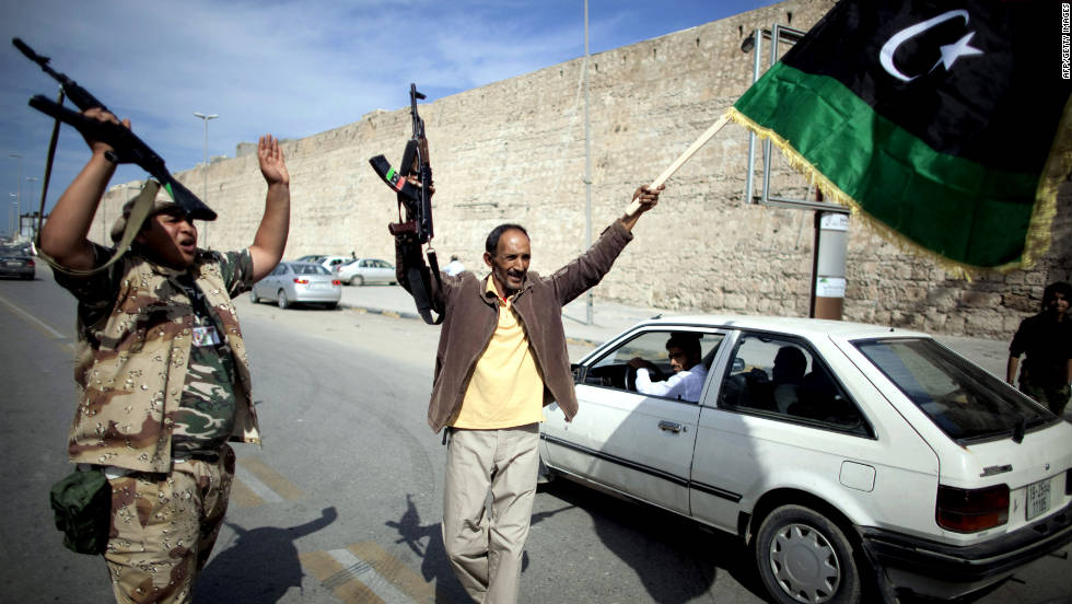 Libyan National Transitional Council fighters celebrate in the streets of Tripoli after news of Moammar Gadhafi's capture in Sirte on Thursday, October 20.