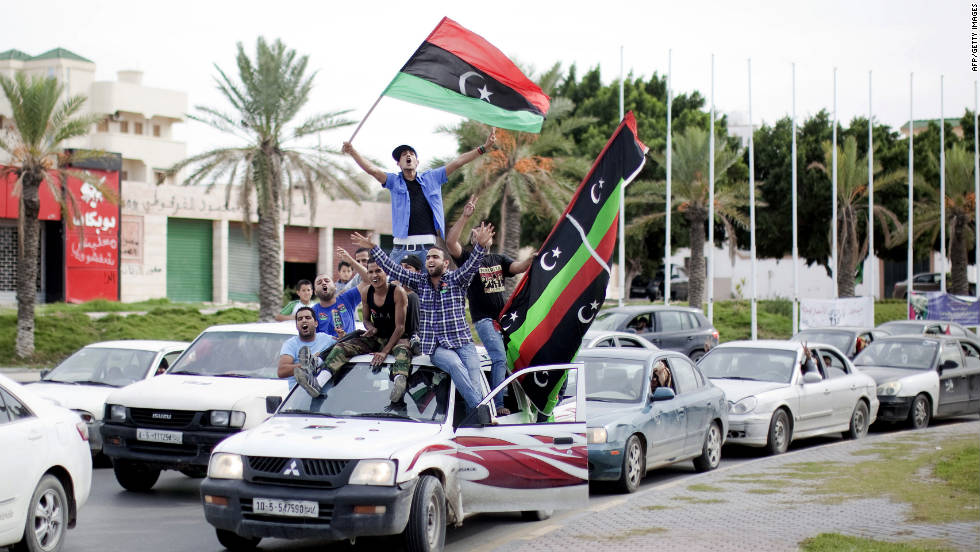 Libyans waving NTC flags celebrate in the streets of Tripoli on Thursday after news of Moammar Gadhafi's capture.