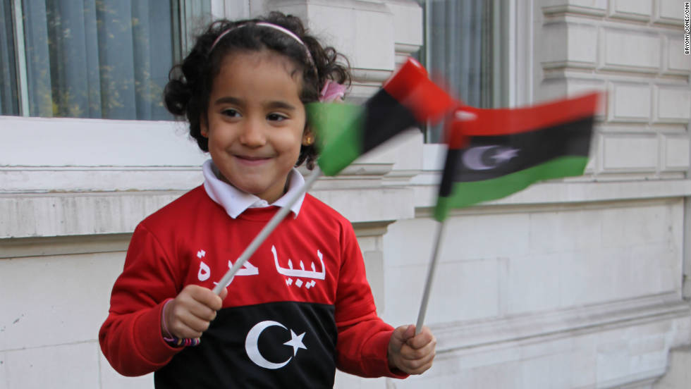 Four-year-old Selsabeel Ageli, whose parents say spent months praying for Libyan dictator Moammar Gadhafi to die, celebrates outside the Libyan Embassy in London.