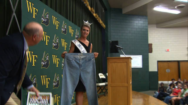 Bree Boyce, who is Miss South Carolina holds a pair of size 18 jeans she wore in high school.