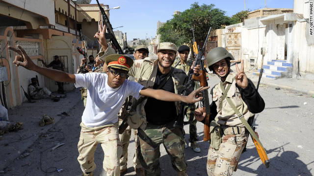 Libyan National Transitional Council fighters celebrate in the coastal city of Sirte after Gadhafi loyalists fell to rebels