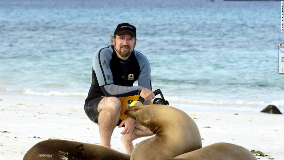 "He was lucky to get this shot taken with a sea lion. ""I just came out of the water after doing some snorkeling and underwater photography, and found a few new friends sitting near my towel and gear."""