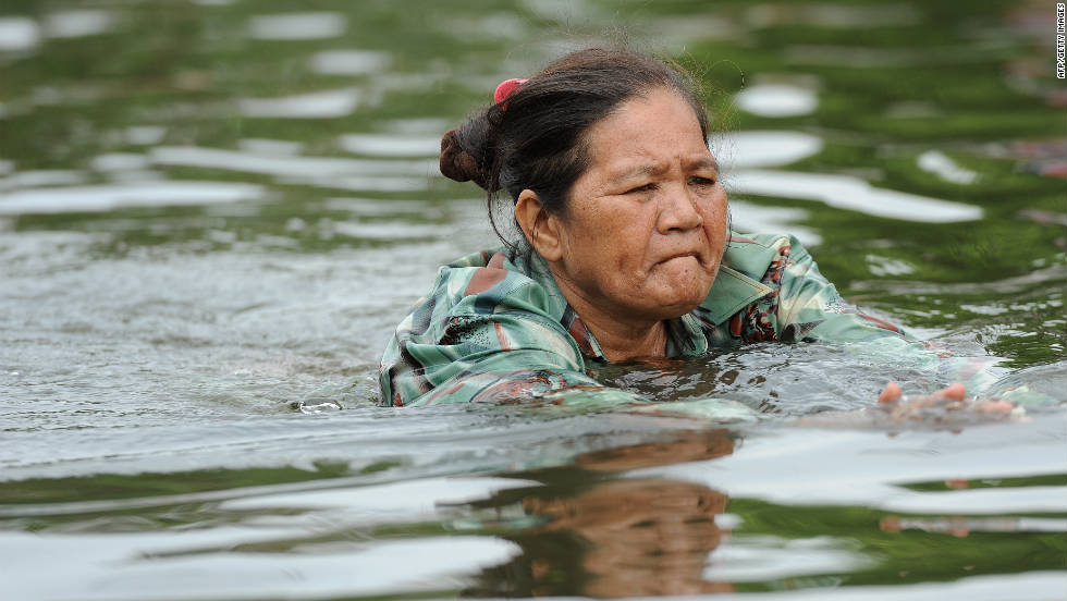 A Thai woman swims in floodwaters in the inundated Ban Bua Thong district of Nonthaburi province, suburban Bangkok on October 20.