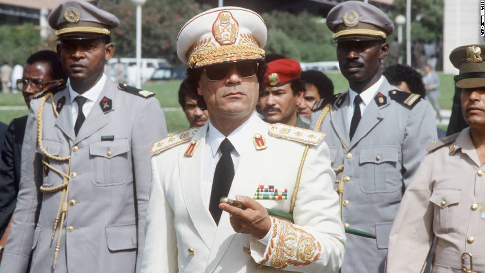 Gadhafi reviews troops on an official visit to Senegal in December 1985.
