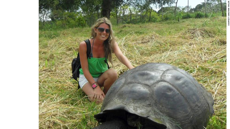 "Christina Taylor of Del Mar, California, poses with a giant Galapagos tortoise. She says she found great adventure and many animal sightings, as well as great food, while visiting the Galapagos Islands. ""The Galapagos Islands were just as amazing as I had expected! I saw the majority of animal species I had sought out to see. ... By far, the best part of getting to see all of these species, was that none of them had any fear towards humans. Sea lions would swim right up to you, birds would land right on you, and most wouldn't even move if they were in your way."""