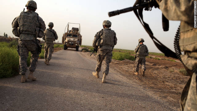 U.S. soldiers with the 3rd Armored Cavalry Regiment walk on a patrol on July 17, 2011, in Iskandariya, Iraq.