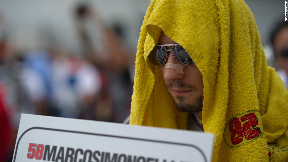 Simoncelli waits on the grid before the start of Sunday's Malaysian MotoGP.