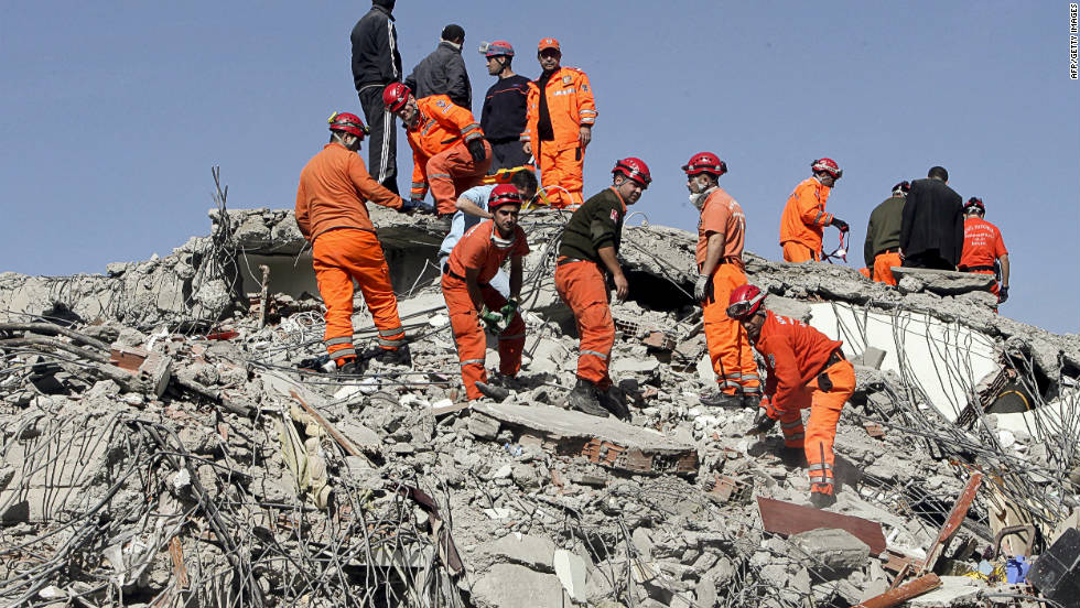 Turkish rescuers try to find survivors in the rubble of a collapsed building in Van on Monday.