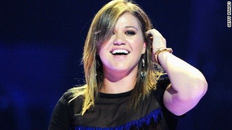 Kelly Clarkson performs at the iHeartRadio Festival in Las Vegas on September 23, 2011