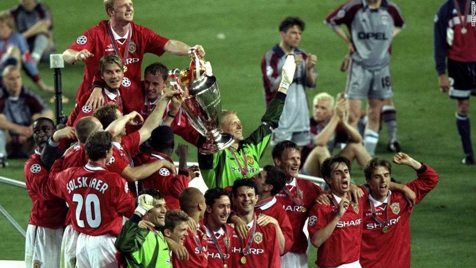 "In 1999 Ferguson took his team to the Champions League final in Barcelona, needing victory against Bayern Munich to complete the most remarkable season in British football history. With United 1-0 down and the clock at 90 minutes, substitutes Teddy Sheringham and Ole Gunnar Solskjaer delivered the most dramatic victory imaginable. ""Football. Bloody Hell,"" Ferguson said afterwards. He was made a Knight -- an order in the British honours system that affords the recipient the title of 'Sir' -- by the Queen, a few months later."