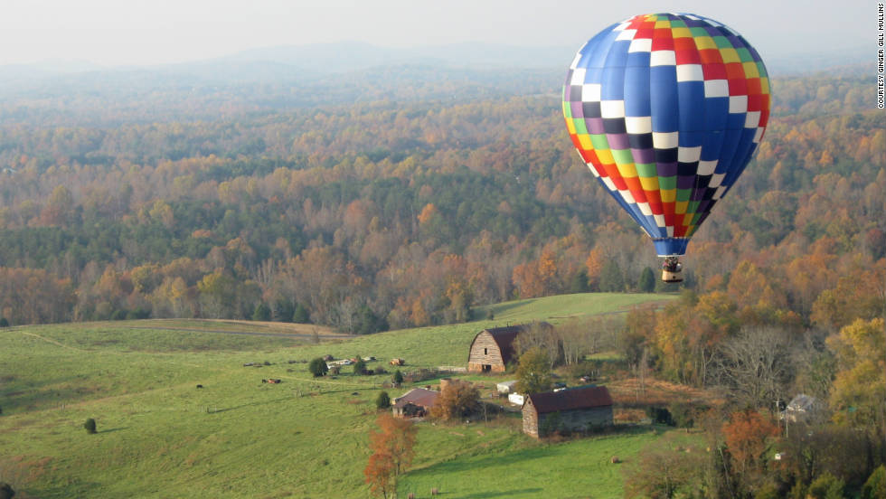 "Ginger Gill Mullins took a photo of this hot air balloon during her own balloon trip over Charlottesville, Virginia. ""It was so awe-inspiring yet peaceful to be in an open basket drifting hundreds of feet off the ground."""