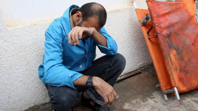 A Palestinian man grieves outside a hospital in Rafa, Gaza, on Saturday.