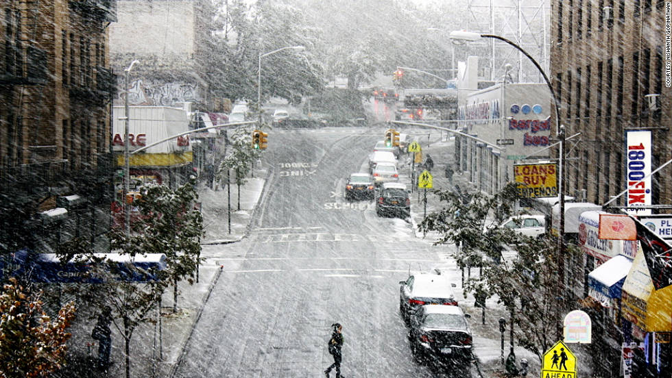 "iReport contributor Nishanth Gopinathan shot this in New York on Saturday, October 29. ""It was alternating between heavy snow fall and freezing rain,"" he said. ""We have about 2 inches of snow, and I can hear tree branches breaking once in a while."""