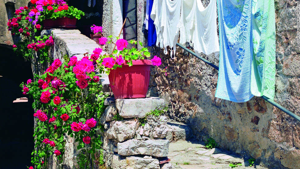 Geraniums add color to the village's 1,000-year old stone walls.