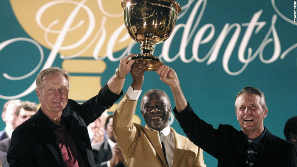 South Africa's then President Thabo Mbeki holds aloft the Presidents Cup with 2003 team captains Jack Nicklaus and Gary Player.