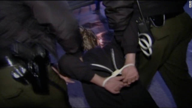 Police in Nashville, Tennessee, take an Occupy protester into custody on Monday.