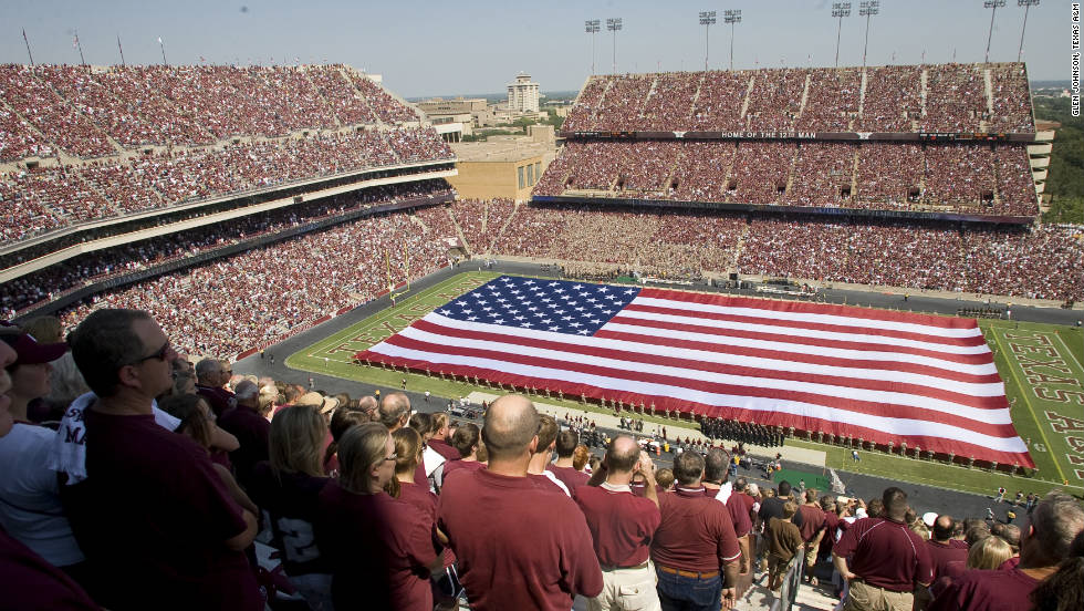 "Aggie students, collectively known as the ""12th Man,"" stand for the entire game at Texas A&M's Kyle Field."