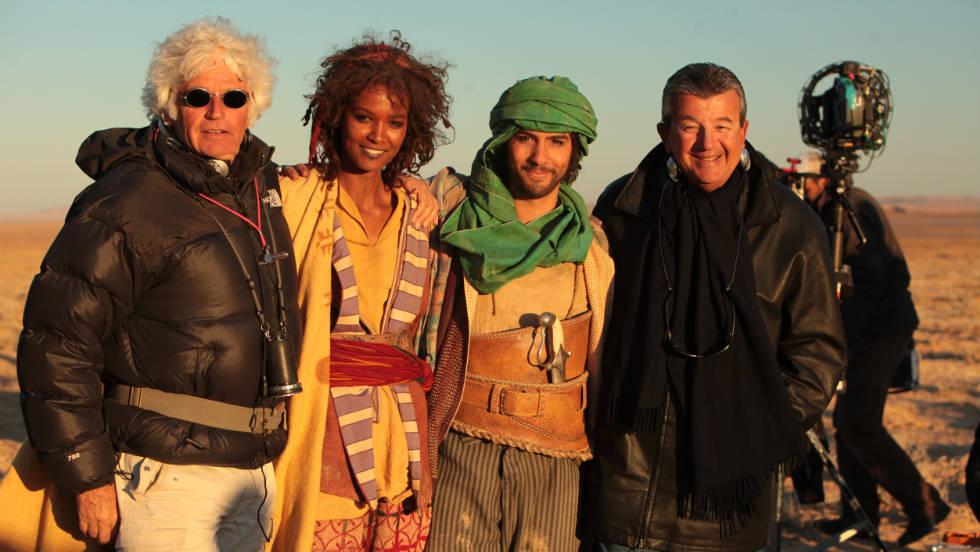 "Director Jean-Jacques Annaud, model and actress Liya Kebede, actor Tahar Rahim and producer Tarak Ben Annar pose between scenes while shooting ""Black Gold."""