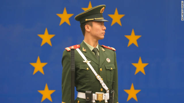 Chinese paramilitary policeman stands guard outside the European Union Delegation in Beijing on October 30, 2011.