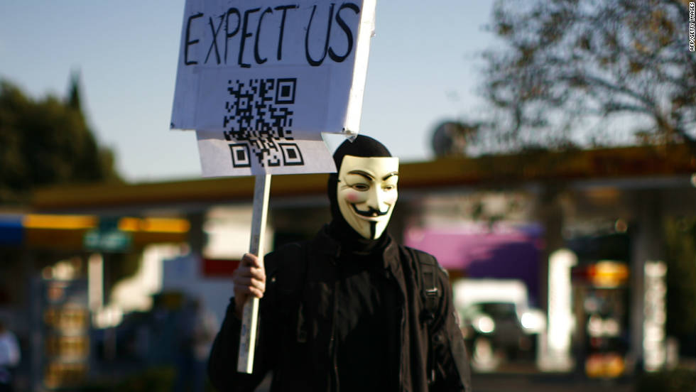 A masked demonstrator marches in Oakland, California on November 2.