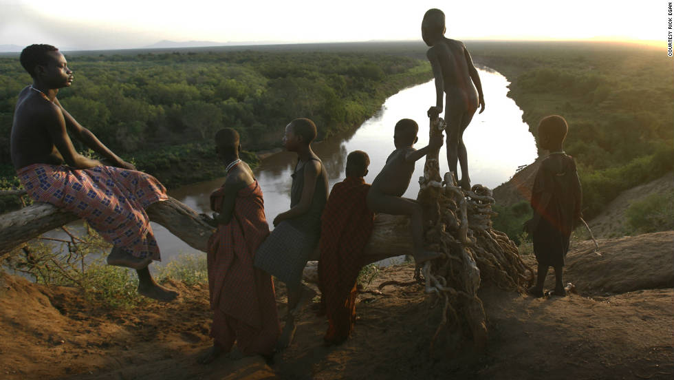 "Children from the Kara tribe gather near the Omo River at dawn. None of them are considered ""mingi."""