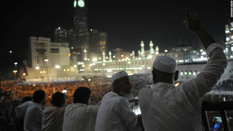 Pilgrims watch fellow Muslims perform the evening prayer in the holy city's Grand Mosque on Wednesday, November 2.