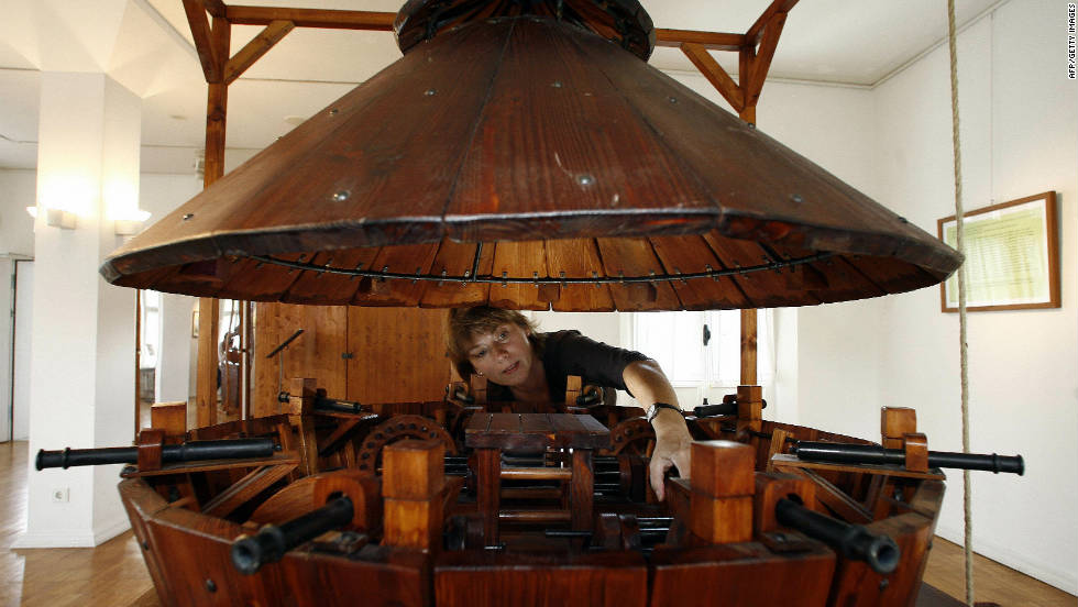 "In 2006, the Galerie Mennonitenkirche in Germany showed an exhibition of ""The Machines of Leonardo da Vinci."" Here, an employee readies the contemporary version of da Vinci's designs for an armored tank."
