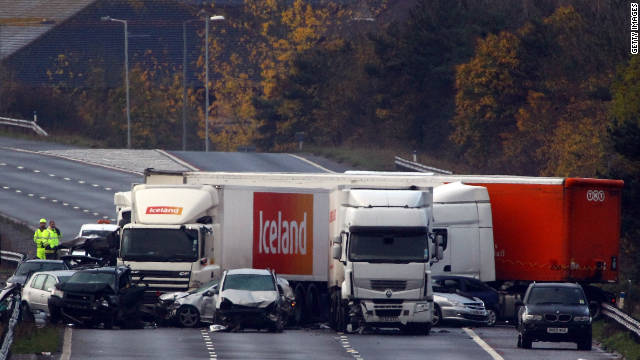 Emergency services attend a multiple fatal collision on the M5 motorway near Taunton, England on November 5, 2011.