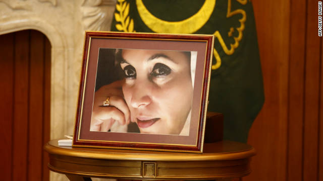 A portrait of assassinated Pakistani President Benazir Bhutto sits atop a table during a meeting between U.S. Secretary of State Hillary Clinton and Pakistan President Asif Ali Zardari in Islamabad on October 21, 2011.