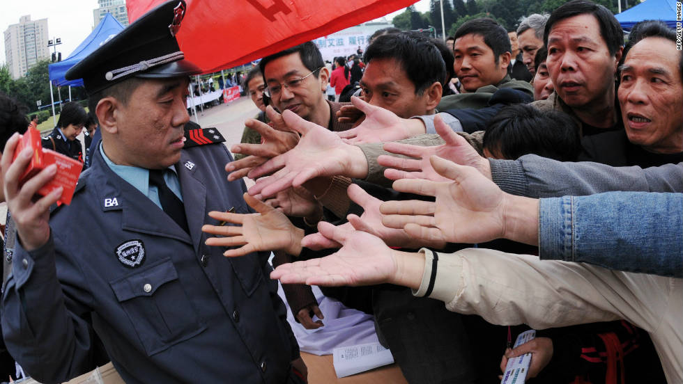 A group of Chinese men gather to collect the free condoms distributed to mark the World's AIDS Day in Fujian province on December 1, 2010.