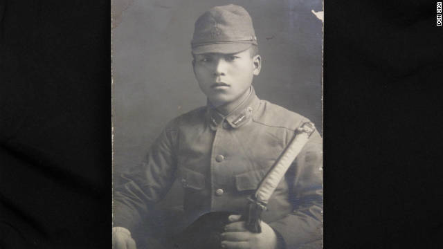 Takeo Oka served in the Japanese Imperial Navy. He's shown in uniform holding samurai sword.