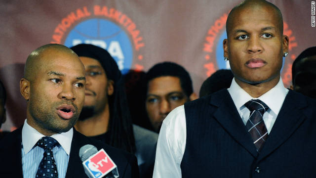 Derek Fisher, left, president of the National Basketball Players Association, speaks next to Maurice Evans on Tuesday.