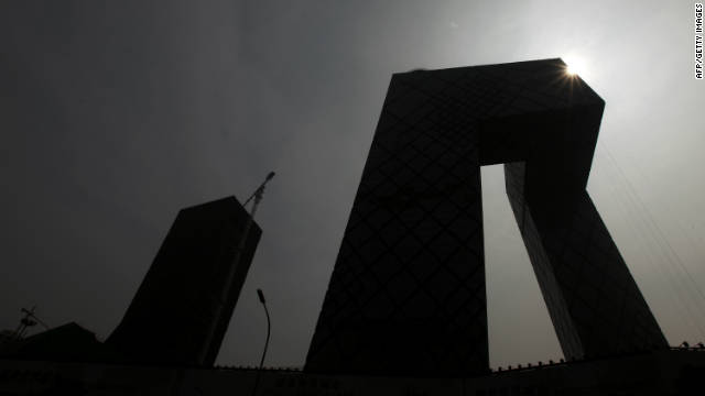 The China Central Television (CCTV) complex is silhouetted in Beijing on August 13, 2010.
