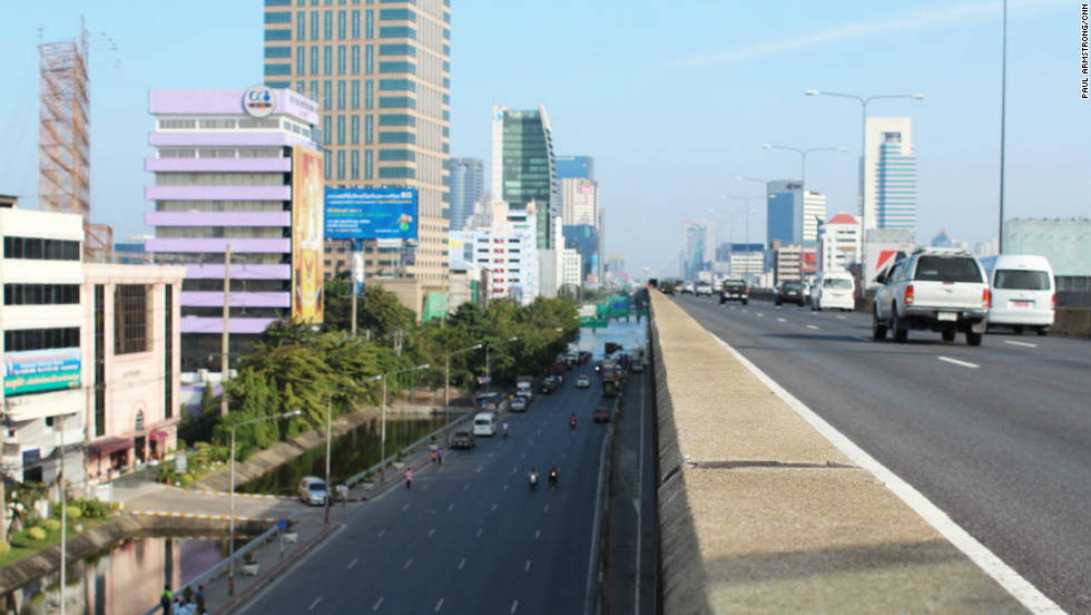 The start of the flooding affecting northern Bangkok can be seen from the side of the main highway to the ancient Thai capital of Ayutthaya. What was once a main road is now a river.