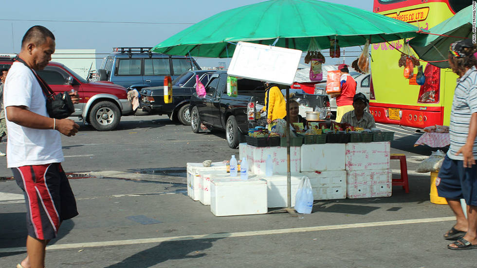 People have even set up camp in the middle of the highway, surrounded by hundreds of seemingly abandoned cars. This couple have even opened up a shop.