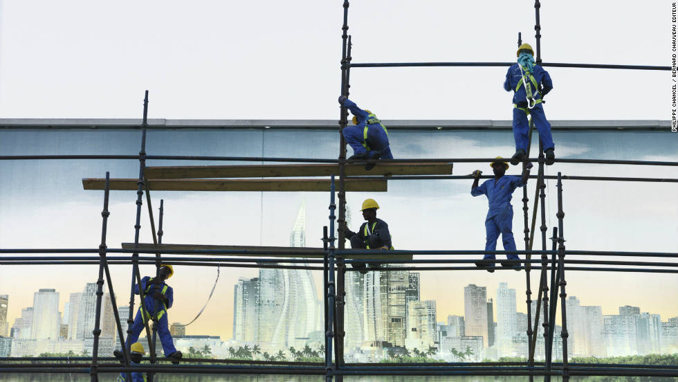 "Workers on a construction site in Dubai. The photographer was most shocked by what he describes as the ""indifference"" of the rest of the population to the workers."