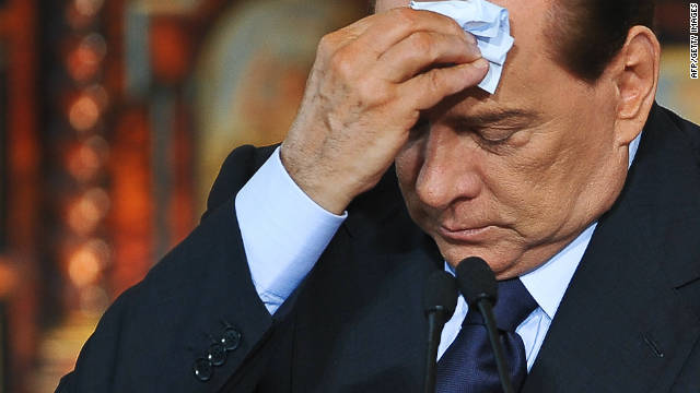 Berlusconi neither down nor out