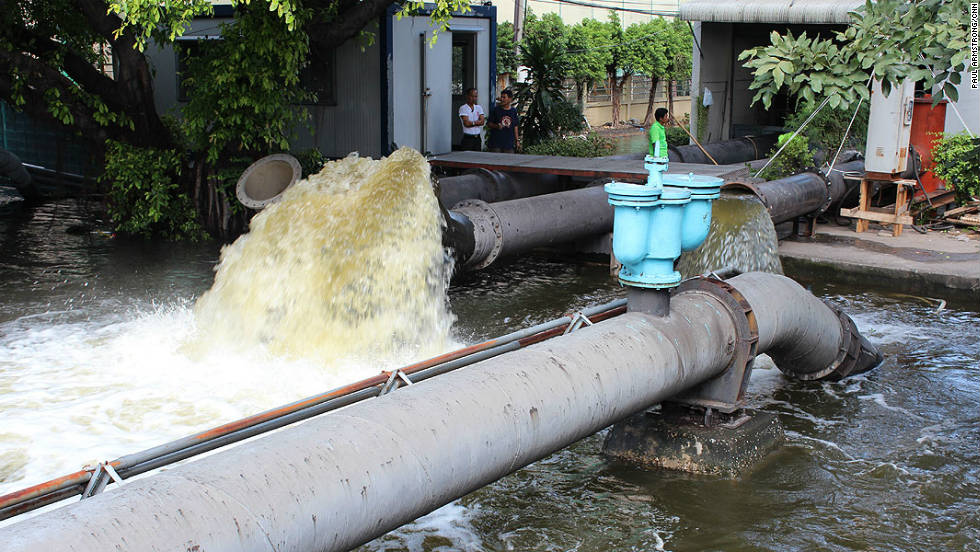Bangkok's commercial district is dry thanks in part to these giant pumps, which suck in the floodwater flowing down from the north of the city and disperse it via the city's canals.