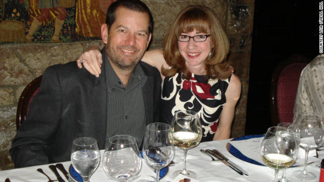 Lisa O'Neill Hill and her husband, Toby, pose for a photo at a dinner in 2011.