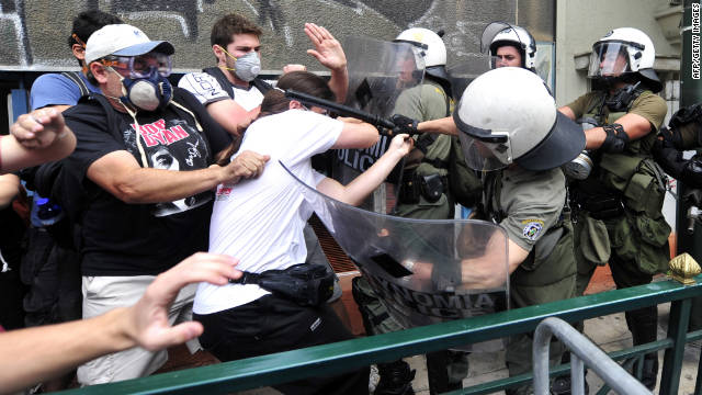 Protesters in Athens, Greece, clash with riot police during a 48-hour general strike in June.