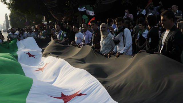 A pro-democracy crowd demonstrates against President Bashar al-Assad outside Arab League headquarters in Cairo on November 2.
