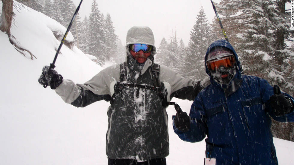 "Patrick Kerr, left, poses with his ""ski buddy"" Mike Sheehy after ""the best ski day ever."" ""It had been snowing all day and it was fresh powder up to our knees with nary a soul around. This was at the end of our last run."""