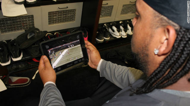Tampa Bay Bucs tackle Donald Penn reviews game footage on his iPad, which has replaced the team's standard playbook.