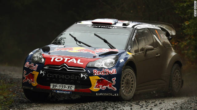 Sebastien Loeb powers his Citroen through as he leads the Wales Rally GB and clinches world title.