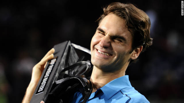 Roger Federer smiles as he lifts the Paris Masters trophy for the first time in his illustrious career.
