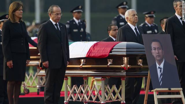 President Felipe Calderon and wife Margarita Zavala pay tribute Saturday to Interior Minister Francisco Blake Mora in Mexico City.