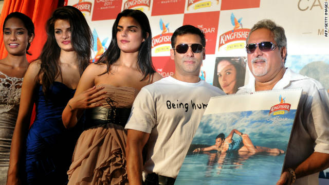 Indian entrepreneur Vijay Mallya (far right) poses with Bollywood star Salman Khan and Kingfisher calendar models.