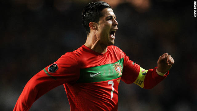 Cristiano Ronaldo celebrates his opening goal for Portugal in Lisbon from a free-kick.