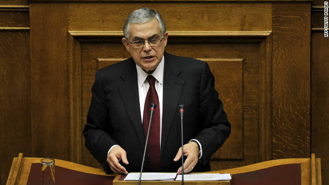 Greek Prime Minister Lucas Papademos speaks to members of the Parliament in his first address to Parliament since taking office.